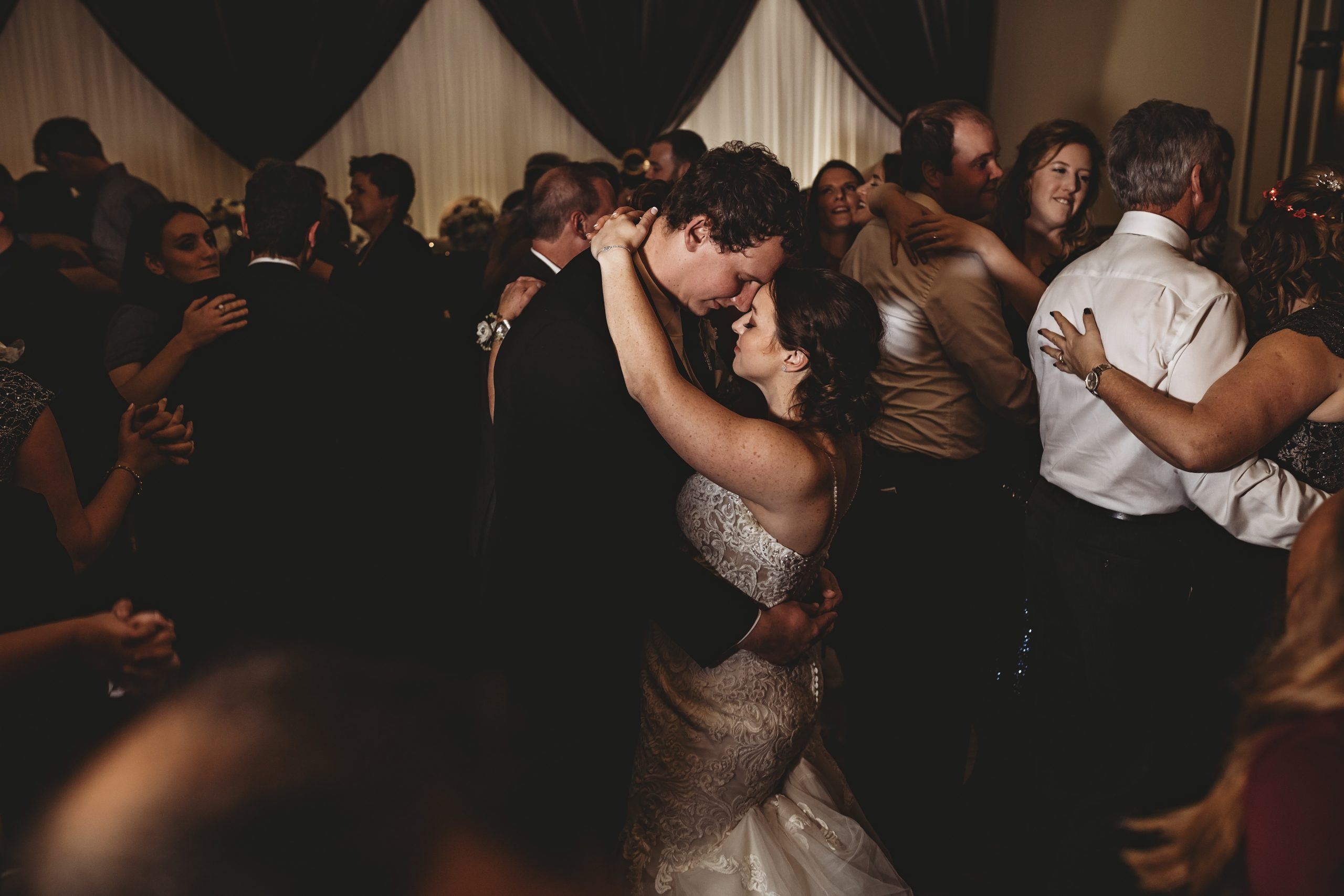 Bride and groom enjoying a slow dance